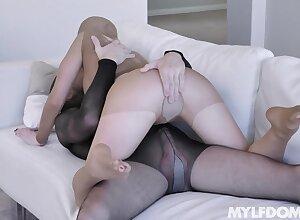 Nylon charm dominatrix Natasha James is fucked by two kinky guy in see through costume